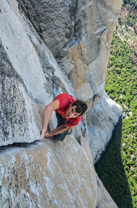 Alex Honnold completes the first free solo climb of famed El Capitan's 3,000-foot vertical rock face at Yosemite National Park.